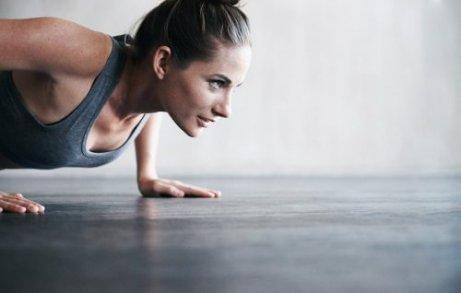 A woman doing push ups.