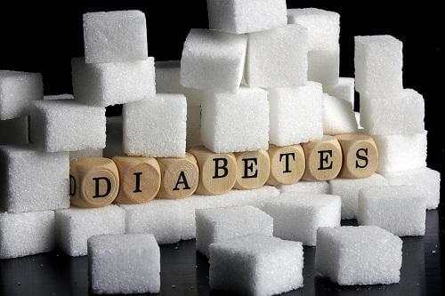 A display of sugar cubes and letters spelling diabetes.