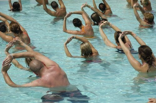 A group of people exercising in a pool.