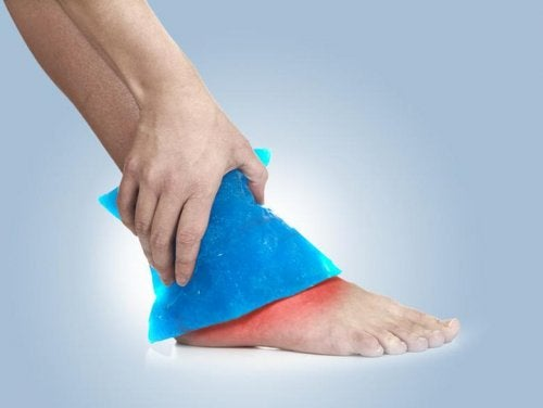 A person applying an ice compress to it's foot.
