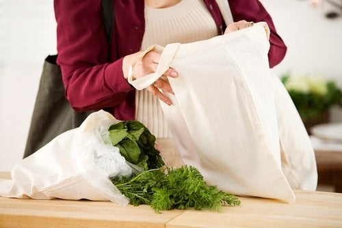 A person with fabric grocery bags.