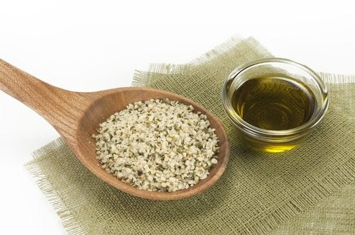 A spoonful of hemp seeds and a bowl of oil.