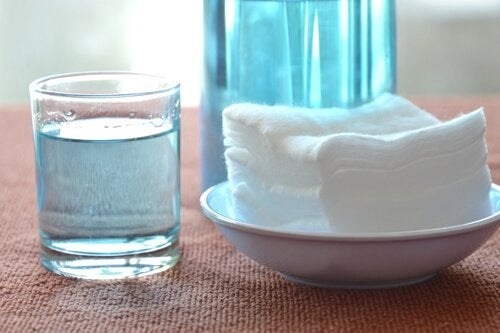 A display of hydrogen peroxide and a bowl with towels.