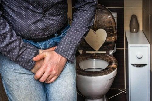 A man near a toilet.