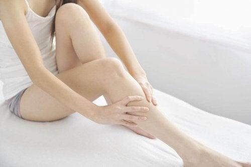 Woman massaging her swollen legs