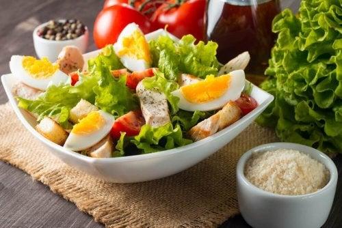 Lettuce, egg, tuna, and tomato salad.