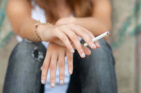 A teen smoking.
