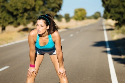 A woman taking a break from jogging.