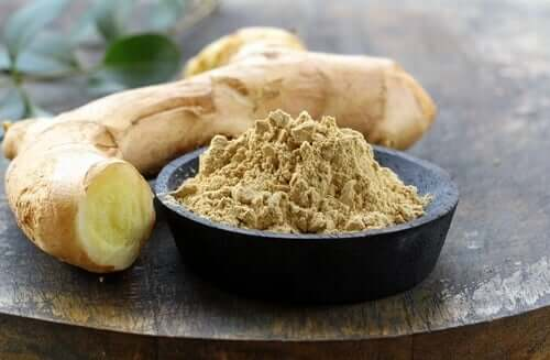 A bowl of ginger powder and root.
