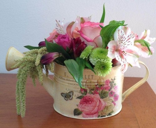 A centerpiece made with a watering can.