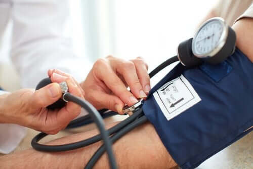 A doctor checking someone's blood pressure.