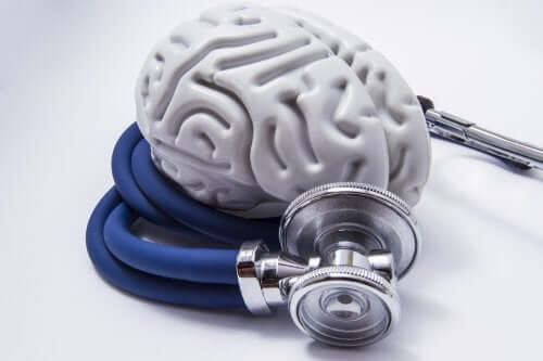 A plastic brain wrapped by a stethoscope.