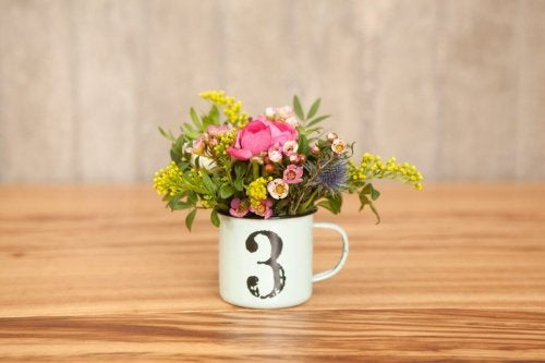 A vase made with a coffee cup.