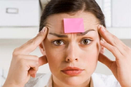 A woman with a post-it on her forehead.