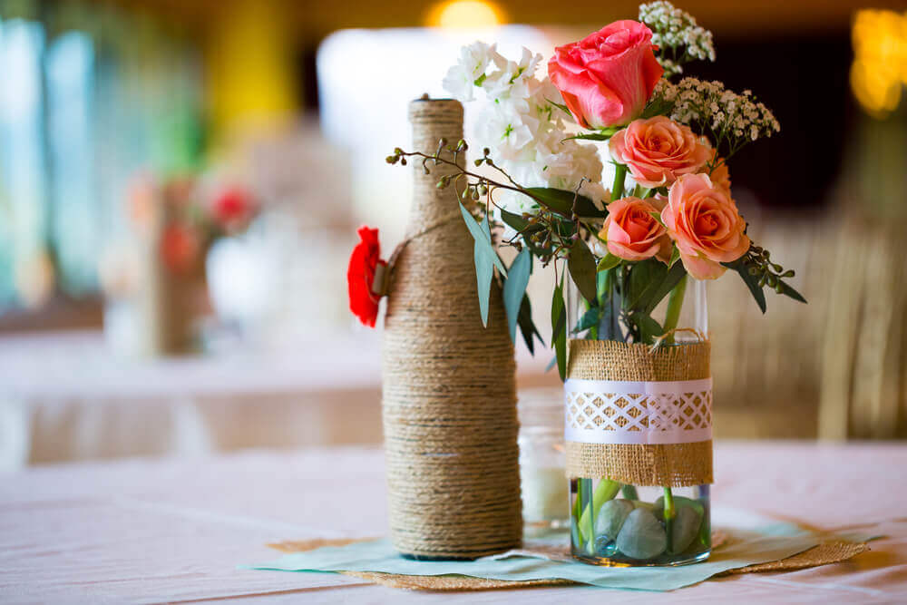 Centerpieces made with bottles.