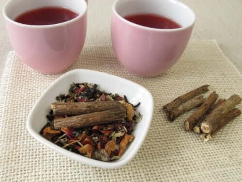 Two cups of licorice tea and a bowl of root.