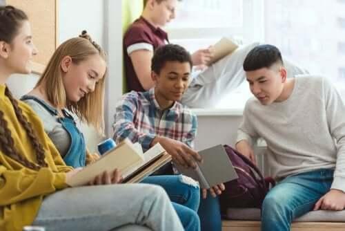 A few preteens reading.