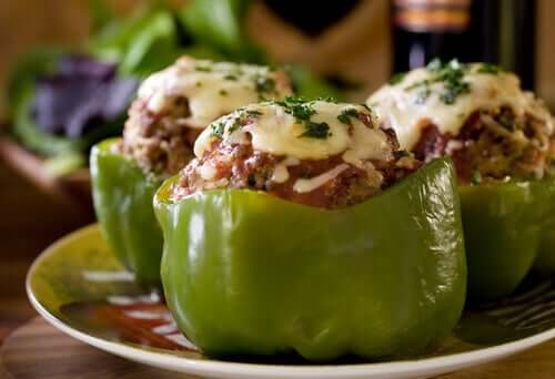 Three stuffed peppers on a plate.