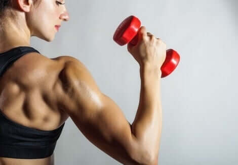 A woman with a dumbbell.