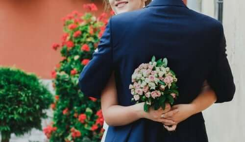 A bride and groom embracing.