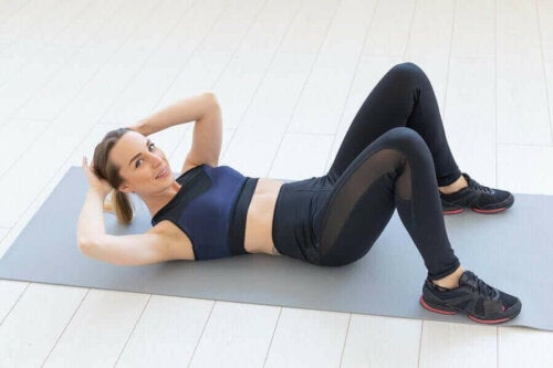 A woman doing exercise on a mat.
