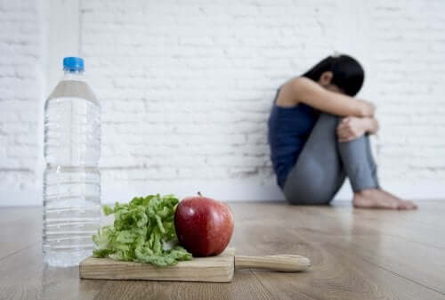 Depressed woman with water and food: factors that affect depression