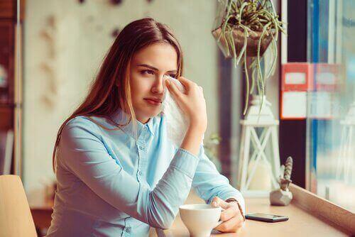 Sad woman having coffee traumatic divorce