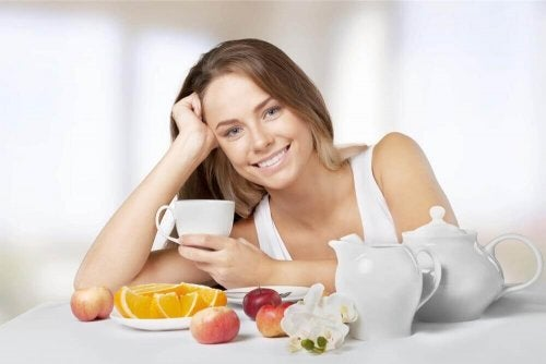 A woman eating fruits.