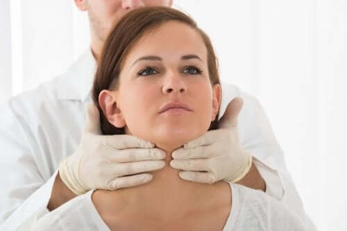 A doctor checking for hyperthyroidism.