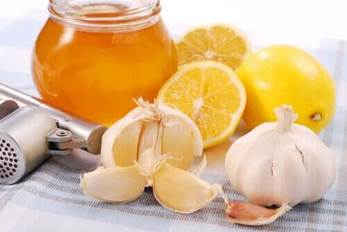 A jar of honey, limes and garlic.
