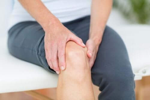 A person massaging their knee.