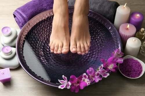 A person soaking their feet as per our burning feet tips.