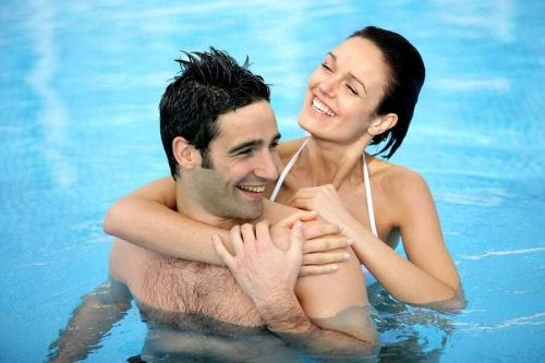 A couple swimming in a pool.