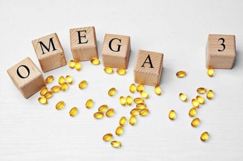 "Capsules and letter blocks forming the word ""omega-3"" for plant sources omega-3"