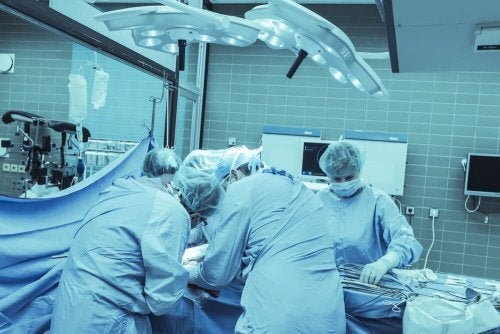 Surgeons performing an amputation.