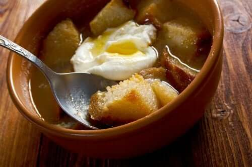 A bowl with an egg and croutons.