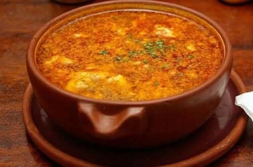 A bowl of garlic and chorizo soup.