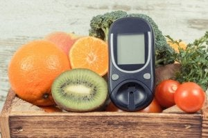 Blood glucose monitor and fruits.
