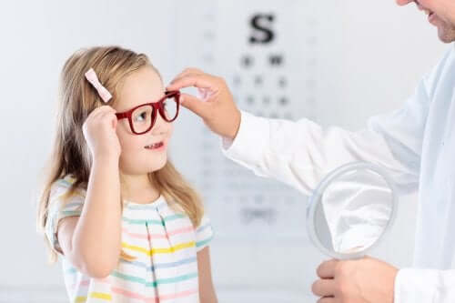 A girl with her eye doctor.