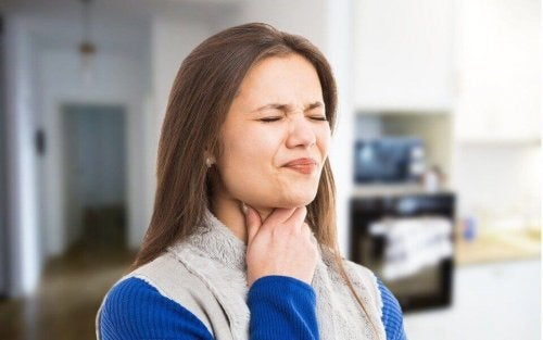 A woman suffering from difficulty swallowing.