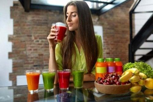 A woman drinking fruit juice.