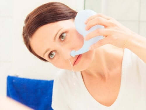 A woman doing a sinus flush.