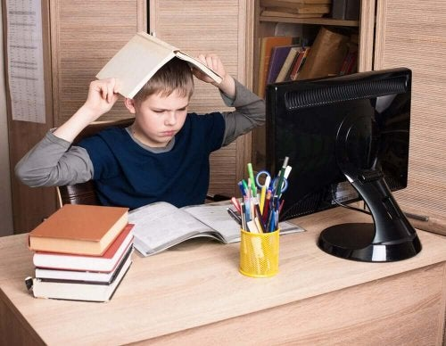 Oppositional defiant disorder in children little boy frustrated and aggressive trying to study