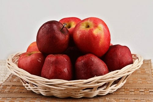 A basket filled with red apples.