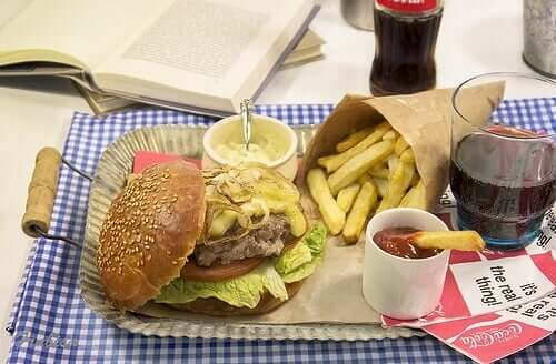 Diet soda cola and hamburger with fries.