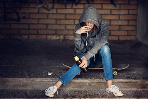 A teenager smoking and drinking.