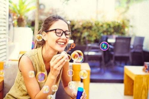 A woman blowing bubbles.