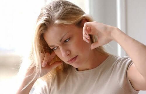 A woman with an earache.