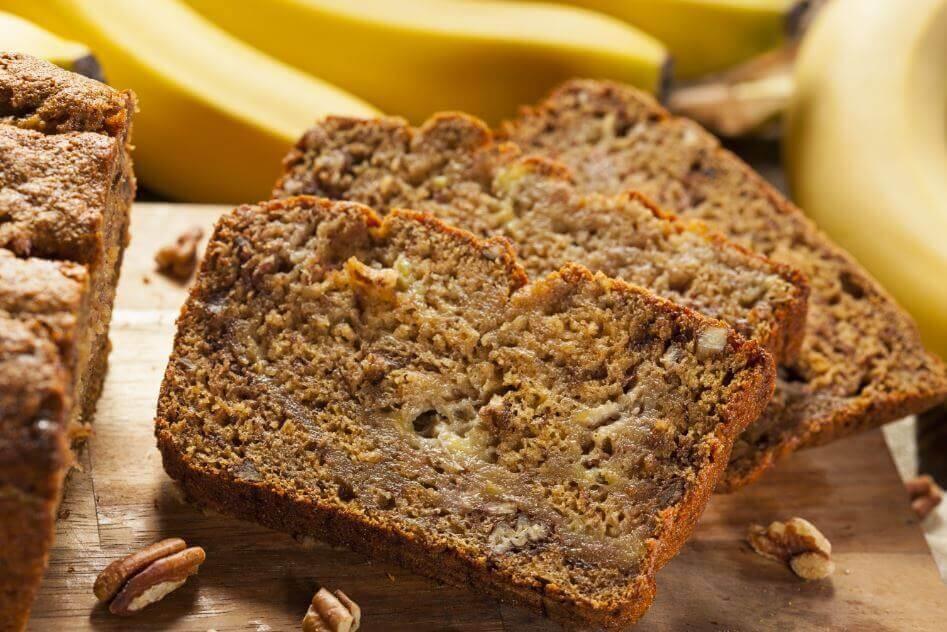 A banana loaf with walnuts.