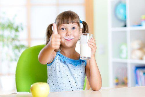 A child drinking milk.